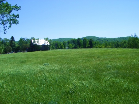 "View of the farm and ""hills"" from the first hay field"