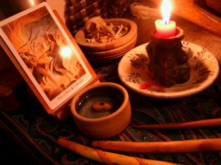 Tarot, Grandmother Crow, and holy water on the altar